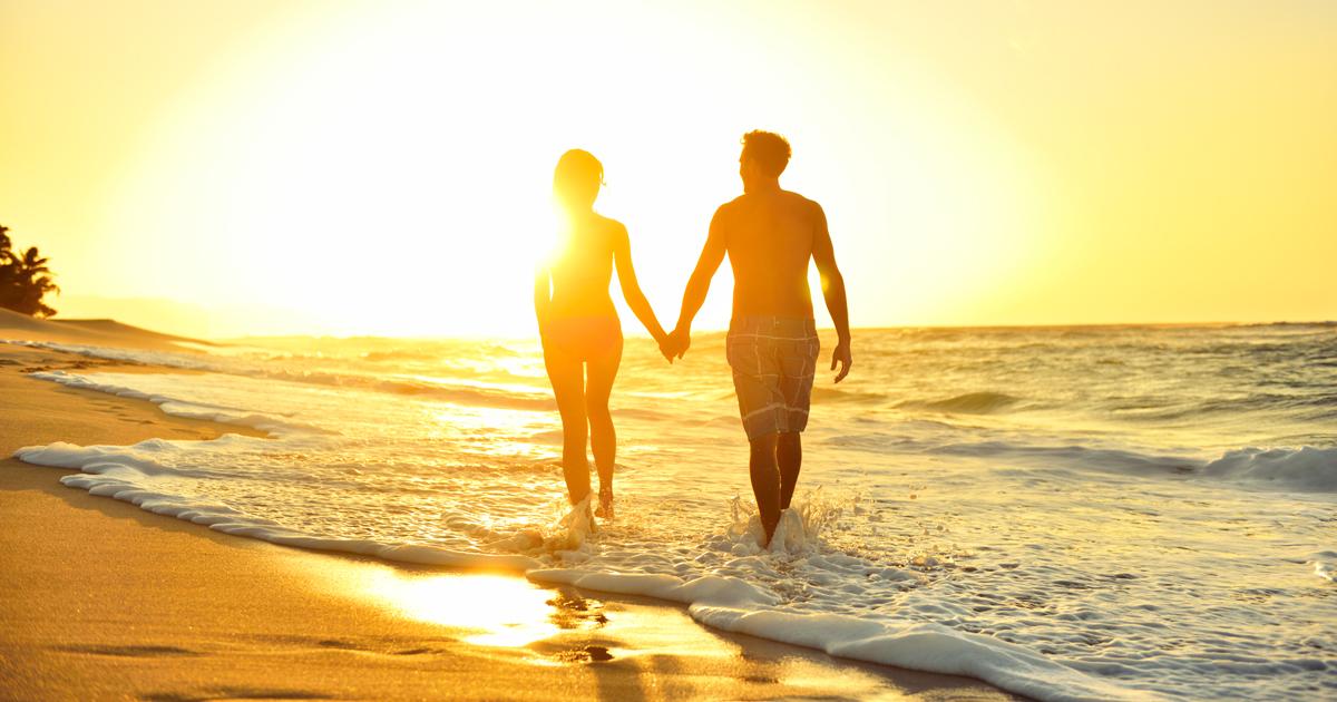 romantic walk on beach in kauai